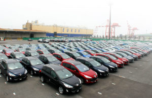 cars are waiting for shipping out of japan